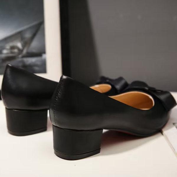 black-leather-heel-back
